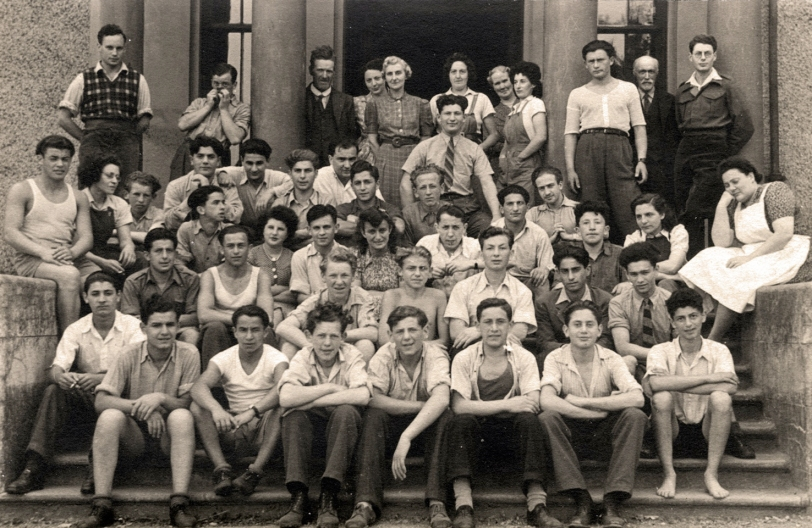 Some of the 732 teenage survivors of concentration camps, in the Lake District, a year after their liberation. My father is sitting on the bottom step, second from left, in a white t shirt.