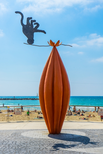 Beach sculpture of a monkey and a cocoa pod. I can't explain it.
